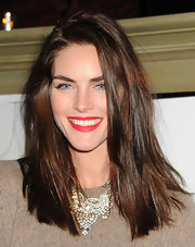 Hilary Rhoda dolled up her sweater with a sophisticated diamond chandelier necklace.