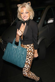 For her arm candy, Pixie Lott chose a quilted teal tote by Miu Miu.