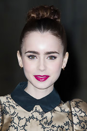 Lily Collins showed off glossy pink lips for the Louis Vuitton FW14 show.