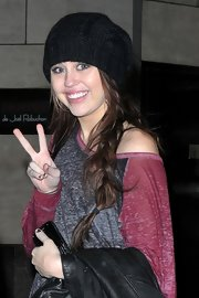 Miley Cyrus accessorized with a cute black cable beanie by  Urban Outfitters for a night out in New York City.