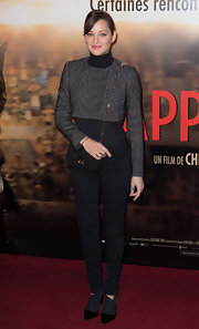 Marion Cotillard finished off her casual-edgy outfit with a pair of two-tone booties by Christian Dior.