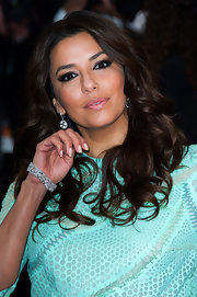 Dangling diamond earrings and a matching bracelet polished off Eva Longoria's look.