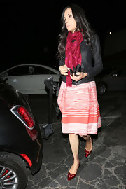 Famke Janssen went out with friends wearing a feminine ensemble featuring a pair of red pointy cutout pumps.