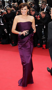 Ines de la Fressange matched her elegant gown with a black velvet clutch at Cannes.