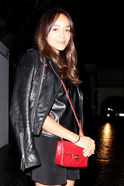 Ashley Madekwe was spotted outside Chateau Marmont looking edgy-glam with this red Chanel bag and black leather jacket combo.