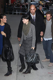Rooney Mara paired her outfit with a tasseled leather tote.