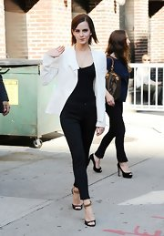 Emma Watson left 'Letterman' looking sleek and stylish in a white blazer layered over a tight black top.