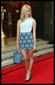 Pixie Lott kept it relaxed yet stylish in a pale blue tank top by Chanel at the Brit's Icon Awards.