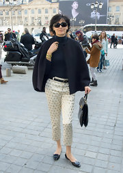 Ines de la Fressange donned a Fall-Winter look featuring a wool jacket at the Giambattista Valli fashion show.