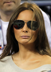 A swipe of nude lipstick completed Melania Trump's matte look while she attended the US Open.