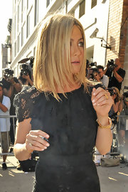 Jennifer Aniston shunned color for her appearance on 'The Daily Show with Jon Stewart,' pairing nude nail polish with a little black dress.