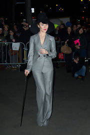 Ulyana Sergeenko traded in her vintage-glam dresses for a gray pantsuit when she attended the Jean Paul Gaultier fashion show.