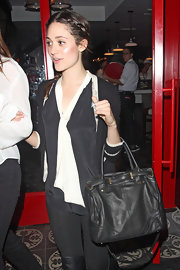 Emmy Rossum accessorized with a soft leather cross-body tote while enjoying a night out at Mercato di Vetro.