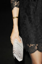 Famke Janssen was spotted at the Gotham Independent Film awards in a black lace dress, a twisted bangle around her arm, and a python clutch on hand.