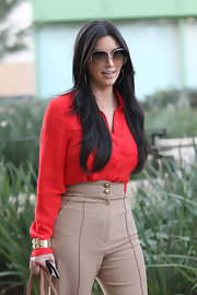 Kim Kardashian channeled the '70s with a pair of oversized sunglasses while out in Beverly Hills.