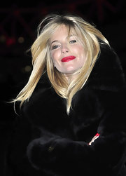 Sienna Miller's red lippy looked striking against her alabaster complexion!