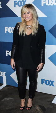 Demi Lovato completed her outfit with black ankle-cuff peep-toes by Schutz.