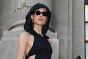 Maggie Q arrived for the Giambattista Valli fashion show looking mysterious in her oval sunnies and hooded outfit.