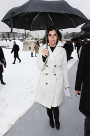 Carine Roitfeld was nice and toasty in black knee-high boots and a trenchcoat during the Dior fashion show.