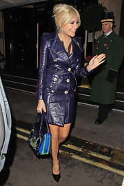 Pixie Lott topped off her fierce ensemble with a color-block patent leather tote.