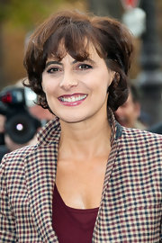 Ines de la Fressange kept it casual with this curly bob at the Chanel Spring 2013 show.