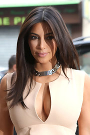 Kim Kardashian took a stroll in Paris wearing a sleek straight center-parted hairstyle.