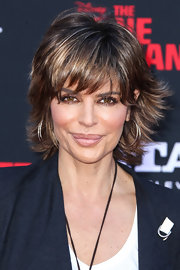 Lisa Rinna's hoop earrings were a chic finish to her look for 'The Lone Ranger' premiere.