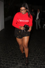Mindy Kaling enjoyed a night out in West Hollywood wearing a red crewneck sweater by L'école des Femmes.