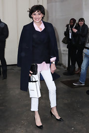 Ines de la Fressange attended Chanel's Spring/Summer 2013 presentation looking casual chic in a pair of black patent pumps.