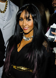Nicole Polizzi attended the Superstars for Sandy Relief event wearing an ultra-long straight hairstyle with wispy bangs.