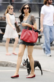 Famke Janssen walked her dog wearing short shorts and a sheer swirl print tunic.