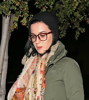 Katy Perry kept warm with a black knit beanie for a dinner out.