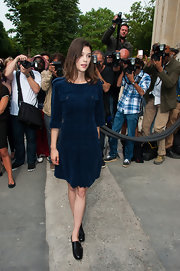 Astrid Berges Frisbey teamed her dress with black leather slip-on shoes by Rupert Sanderson.