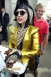 Lady Gaga went for all-out shimmer with this gemstone chandelier necklace and gold blazer combo while out in London.