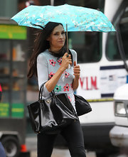 Famke Janssen was out and about NYC one rainy day wearing a tee, skinny pants, rainy boots, and a roomy tote on her arm.
