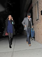 Former Bond girl Famke Janssen was spotted out with boyfriend wearing a tunic, tights, a trenchcoat and a pair of leather knee-high boots.