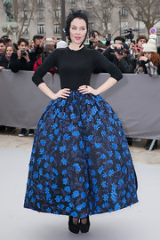 Ulyana Sergeenko cut an exaggerated silhouette in a Christian Dior dress with a super-flared floral skirt.