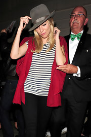 Sienna Miller accessorized with a gray fedora for added spice to her look.
