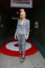 Gwen Stefani chose a pantsuit with a dizzying print for the launch of her Harajuku Mini clothing line.