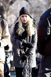 Imogen Poots completed her toasty ensemble with a pair of black mittens.