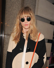 Suki Waterhouse hid her eyes behind a pair of round sunnies as she arrived for the special screening of 'The Great Gatsby.'
