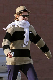 Emma Watson looked extra warm wearing a white scarf with her sweater.