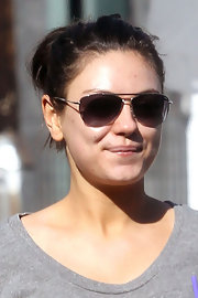 Mila Kunis accessorized with a pair of aviators for a coffee run.