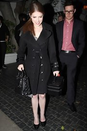 Anna Kendrick went for classic styling with this black trenchcoat during a night out in Hollywood.