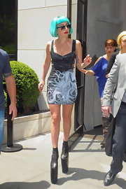 Lady Gaga was spotted outside her New York City hotel wearing a sexy cutout mini dress printed with the cover of her album, 'Born This Way.'