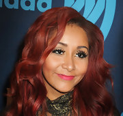 Nicole Polizzi added a bright pop with some pink lipstick.