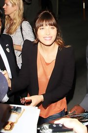 Jessica Biel left the 'Tonight Show with Jay Leno' wearing a black cropped jacket over an orange blouse.