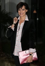 Ines de la Fressange sported a pretty Roger Vivier oversized satin purse at the Sidaction gala dinner in Paris.