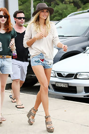 Jessica Hart added inches to her legs with a pair of woven strappy wedges.