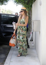 Jessica Alba lugged along a fully packed Prada canvas tote.